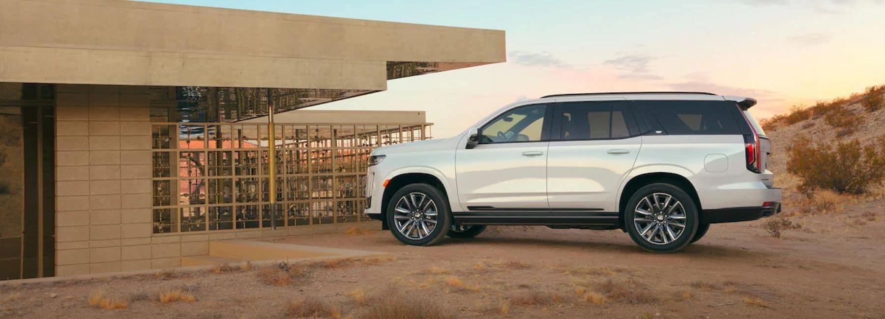 White 2021 Cadillac Escalade In Desert Next To A Building - Cadillac Dealer Near Las Cruces, NM