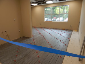 September 30, 2016 - The new tile for the client waiting area. Sunnyside Acura Nashua, NH