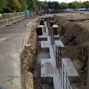 September 23, 2015 - Footing complete on the left side. Getting the rebar set up for the foundation walls.
