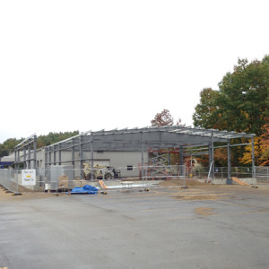 "October 16, 2015 - The service department expansion has been framed out. The new ""vehicle spa"" drive-through can be seen on the left side."