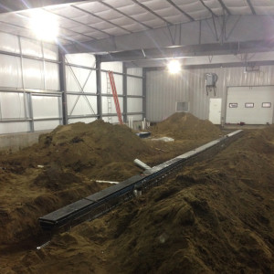 December 4, 2015 - The drain is being set down the middle of the new service department vehicle maintenance area.