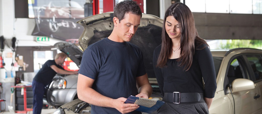 Mechanic showing the cost of service to client