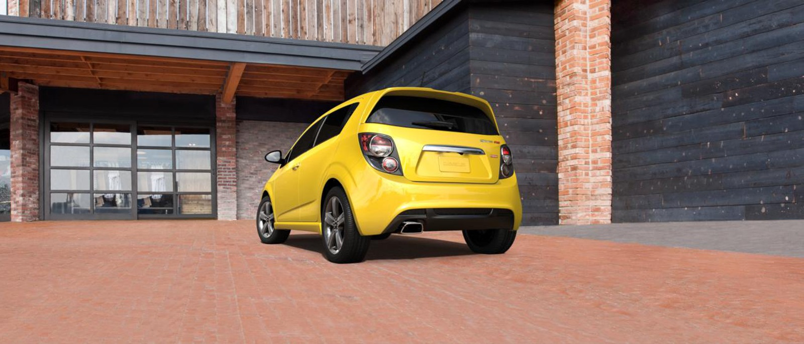 2016 Chevy Sonic Yellow backside exterior view