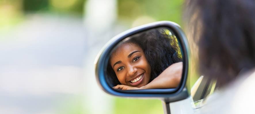 Teen Driver in Side Mirror