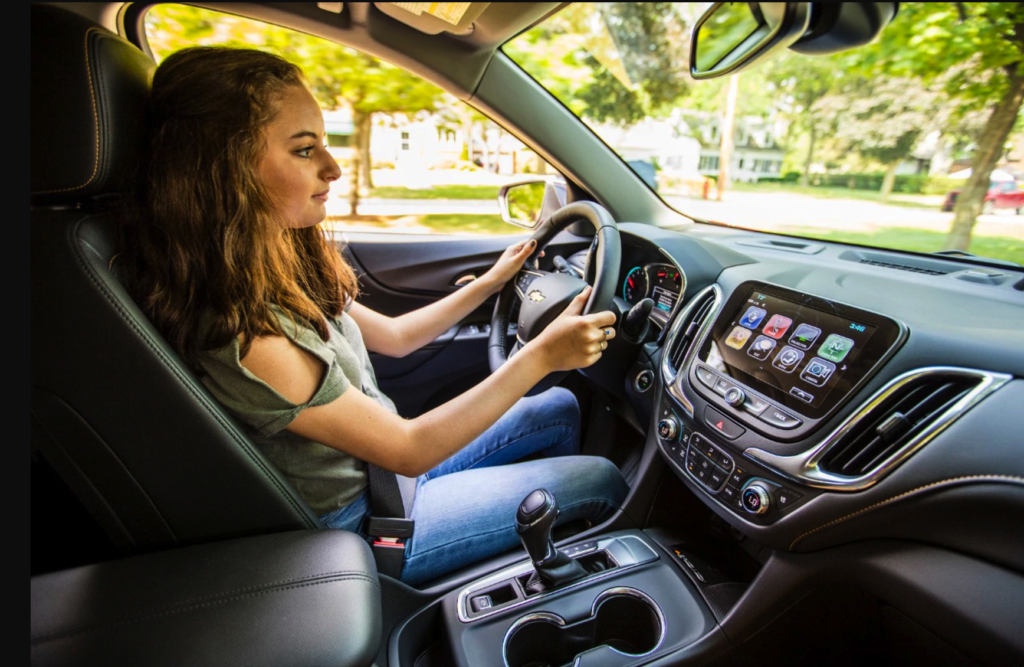 Interior View of Teenager Driving at Wheel of Chevrolet Vehicle