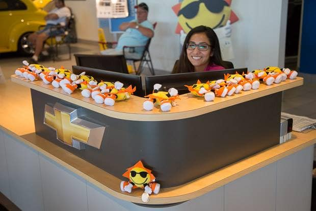 Sunrise Chevrolet dealership receptionist with Sunrise Chevrolet mascot toys