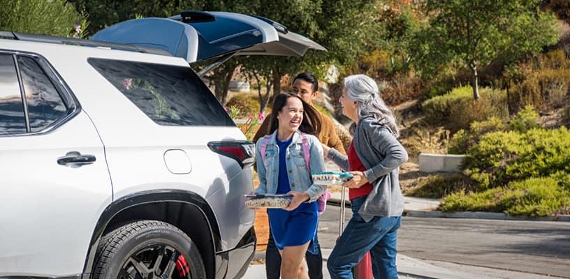 Family walking to Chevrolet SUV