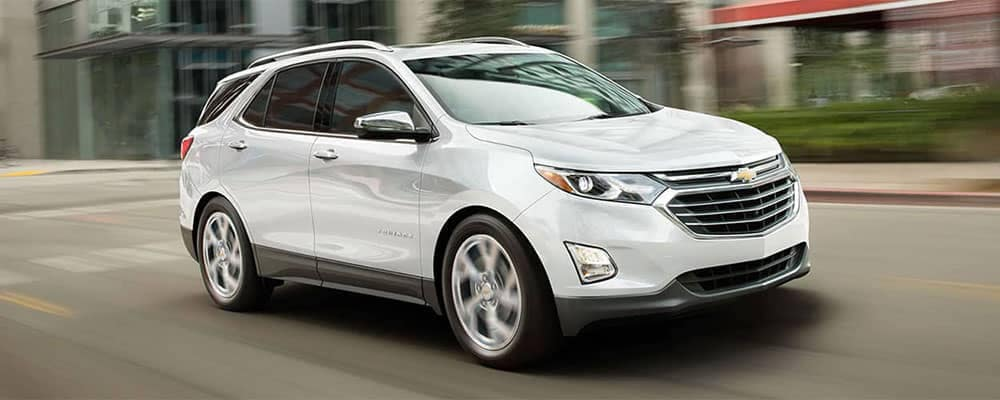 2019 Chevrolet Equinox white Driving in City