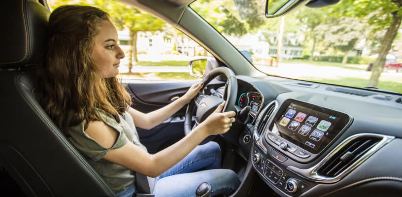Teenager Driving Chevrolet Vehicle