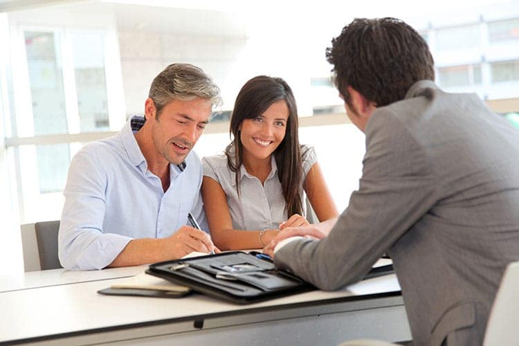 Father and teenager signing loan contract 18260813