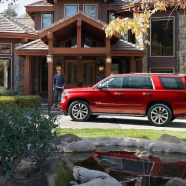 2019 Chevrolet Tahoe parked in front of home