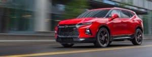 Red 2019 Chevrolet Blazer driving down a street