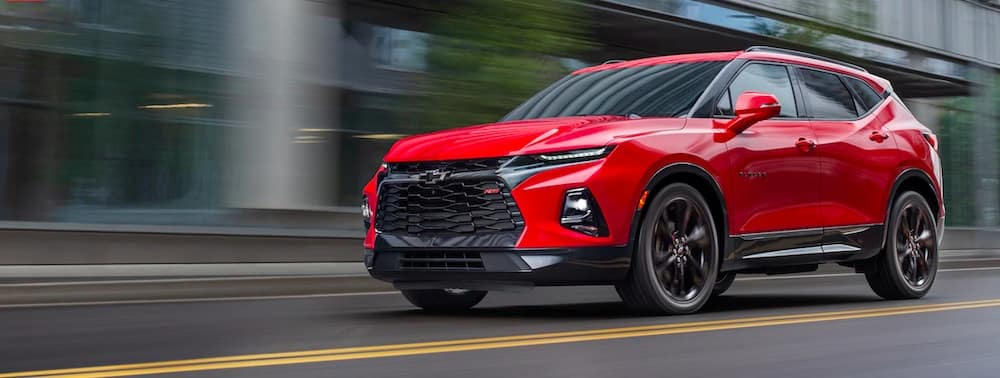 Red 2019 Chevrolet Blazer driving down a street