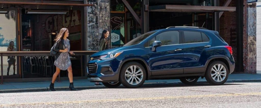 women walk to 2019 Chevrolet Trax
