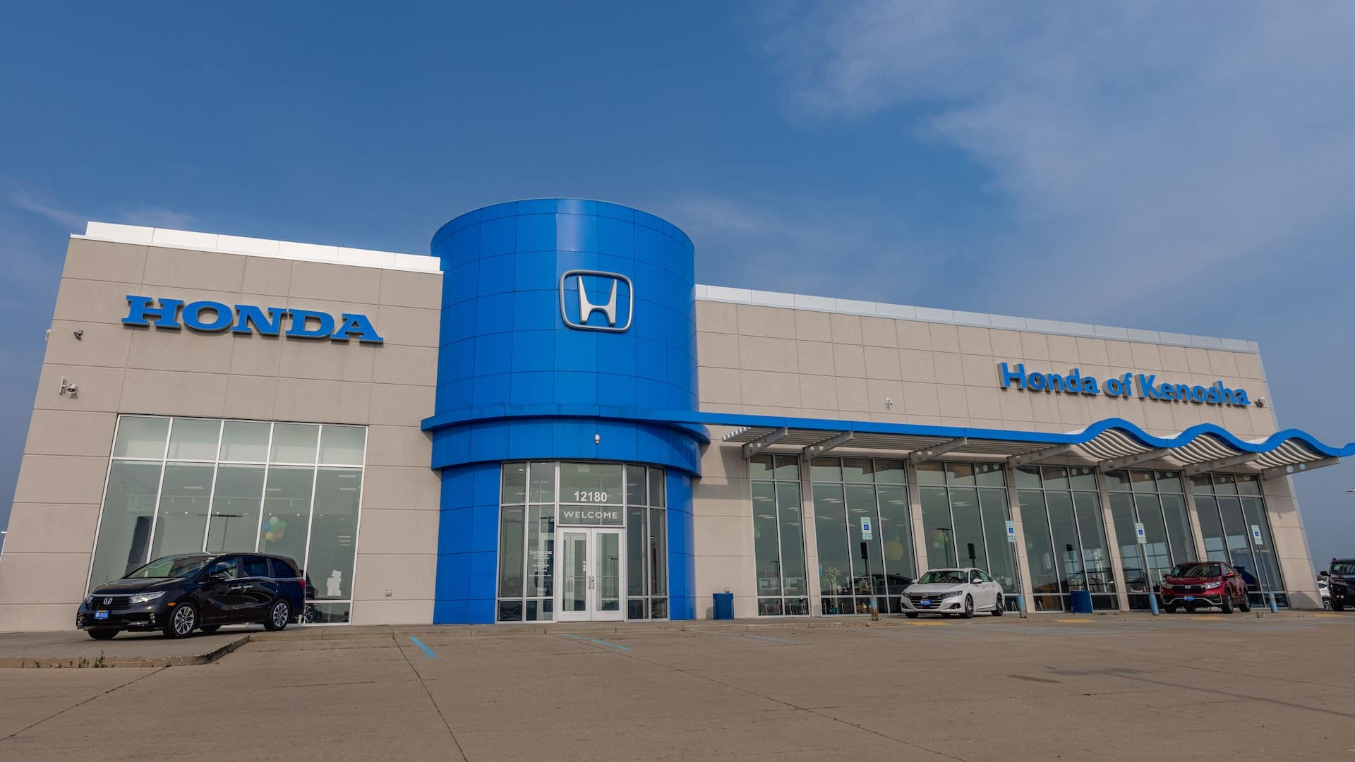 An exterior shot of a Honda dealership.