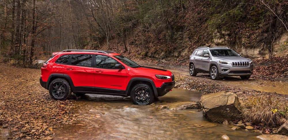 2019 Jeep Cherokee Vehicles on Dirt Road