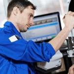 Mechanic Performing Tire Alignment