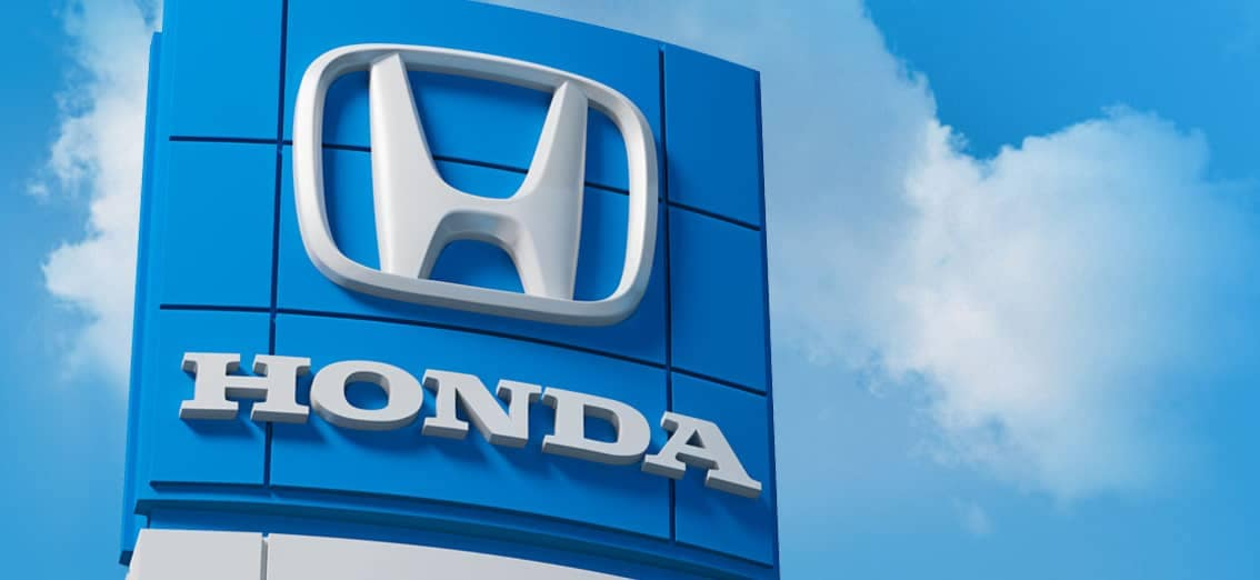 Bue Honda Sign With Clouds