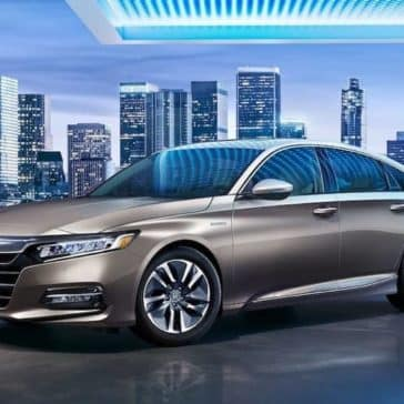 2019 Honda Accord with city skyline backdrop