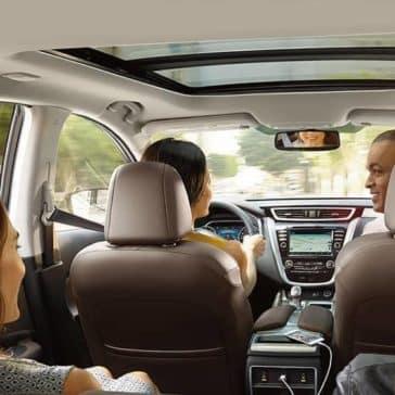 2018 Nissan Murano interior cabin with passengers