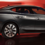 2019 Nissan Maxima with red background