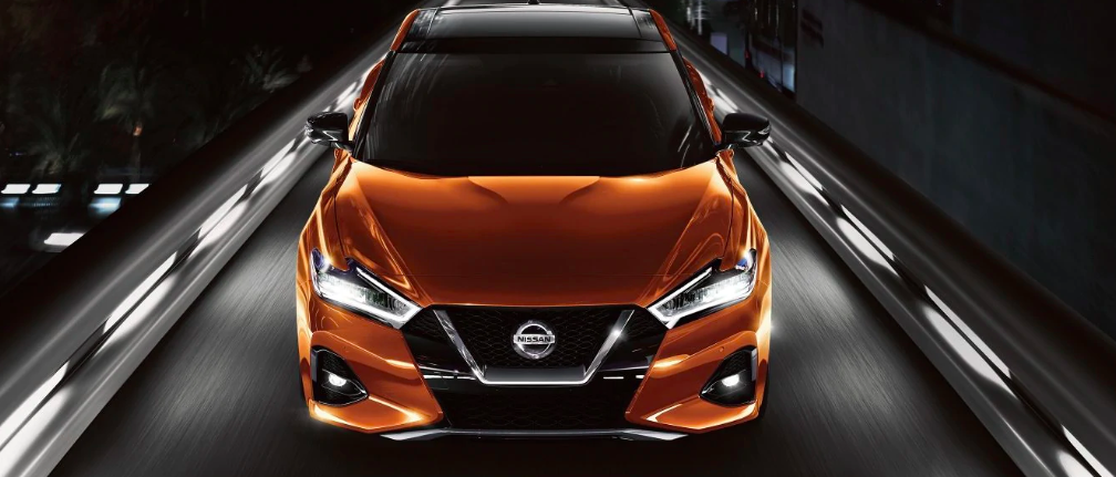 Orange Nissan Maxima at Night