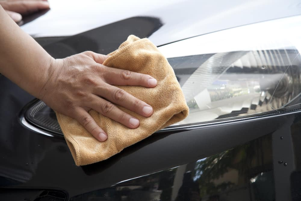 Drying a car with a microfiber cloth