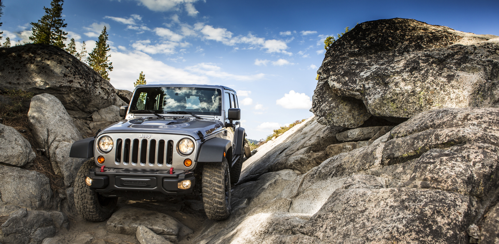 Silver 2013 Jeep Wrangler rock crawling