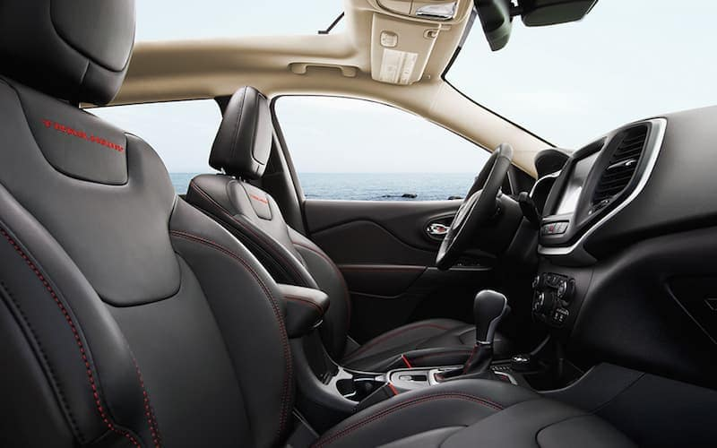 The black interior of a 2014 Jeep Cherokee