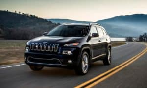 A 2014 Jeep Cherokee Trailhawk on a highway