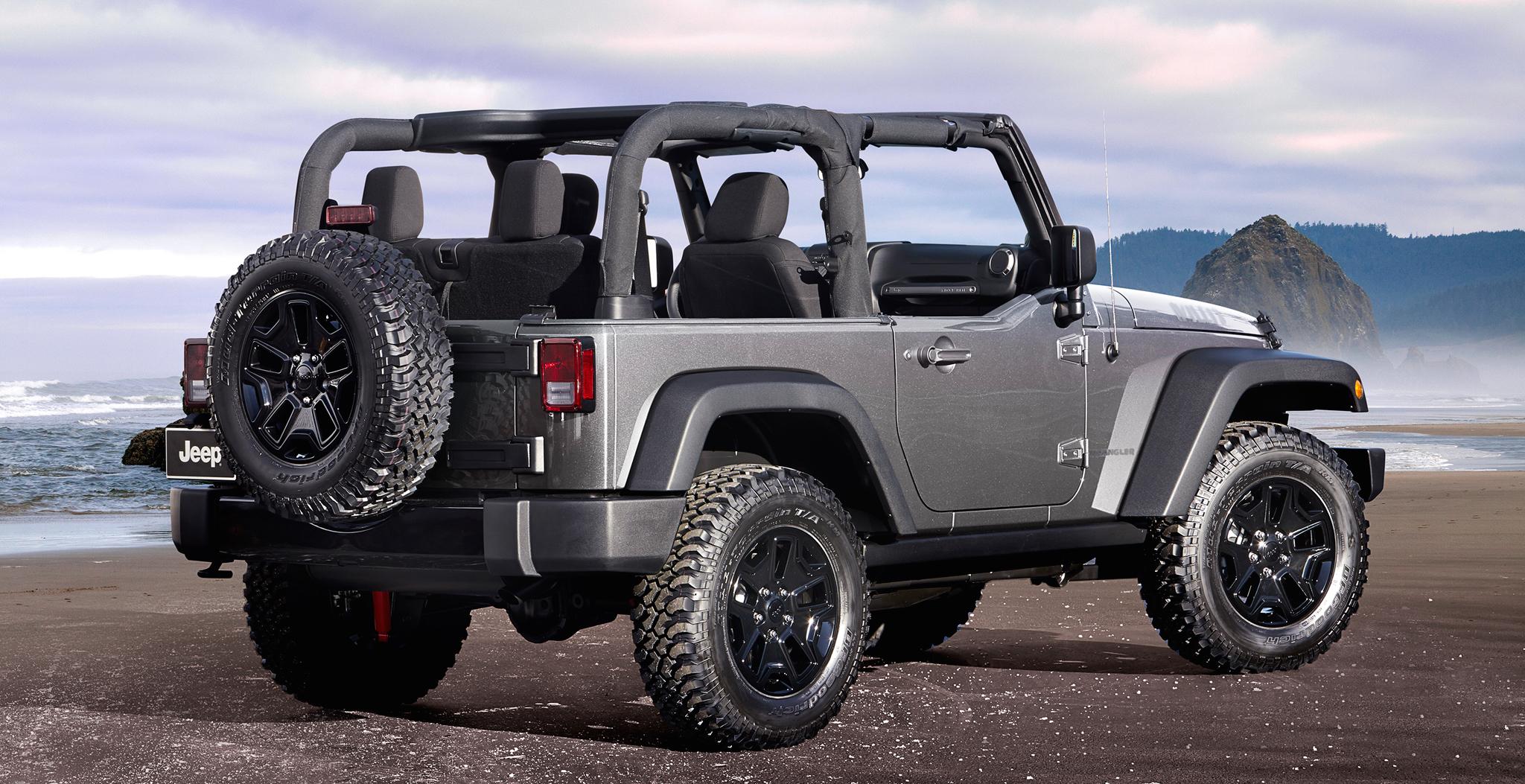 Silver 2015 Jeep Wrangler on mountain beach