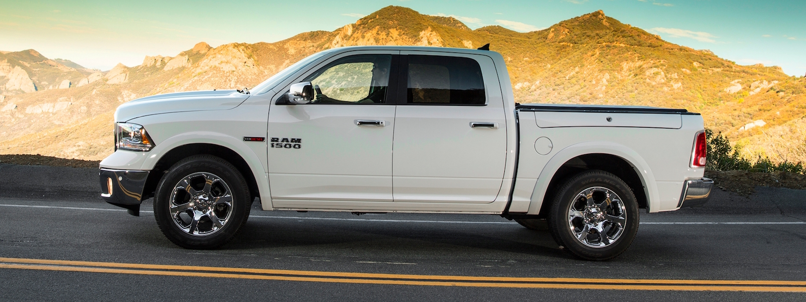 White 2014 RAM 1500 Driving on desert road – Colorado Springs, CO