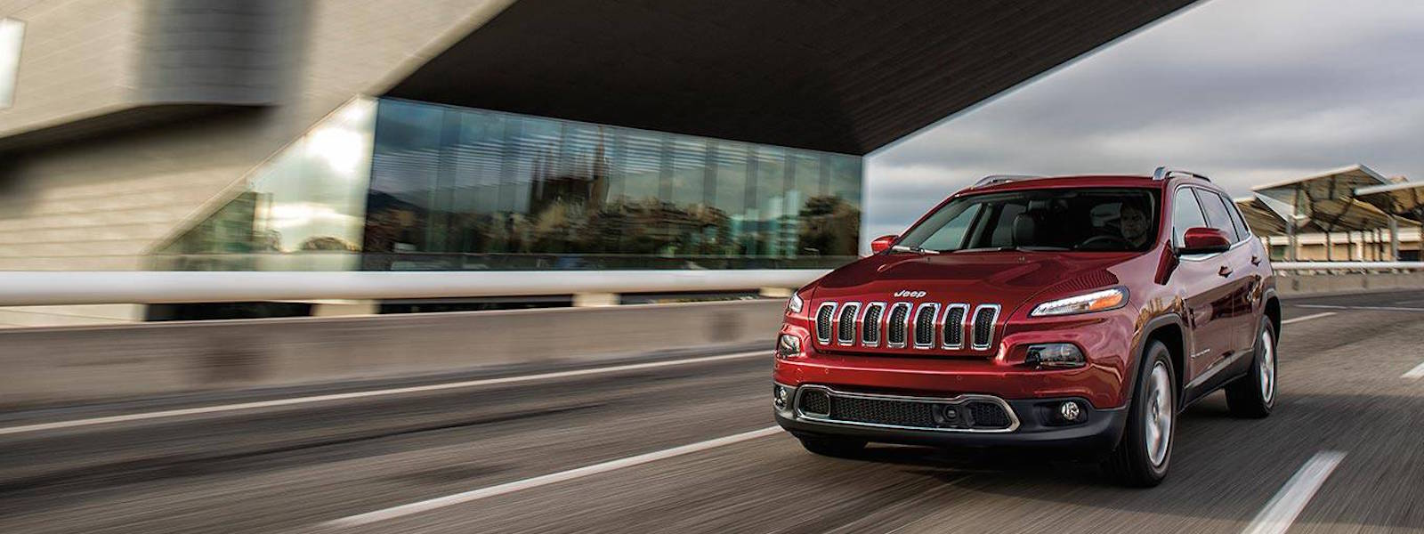2016 Jeep Cherokee Performance driving under overpass building in Colorado Springs, CO.