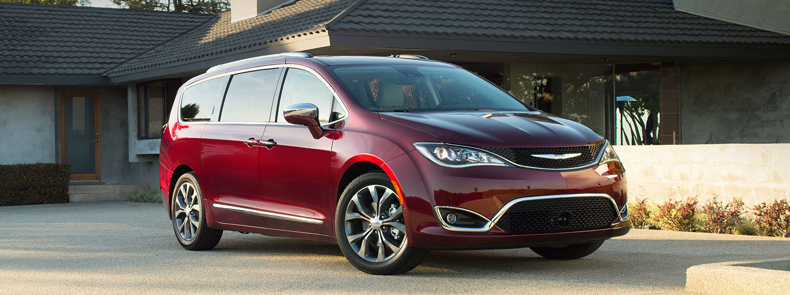 Red 2017 Chrysler Pacifica Performance Parked outside a house