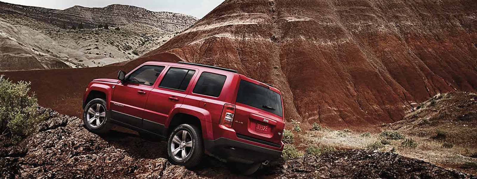 Red 2016 Jeep Patriot off roading in the desert – Colorado Springs, CO