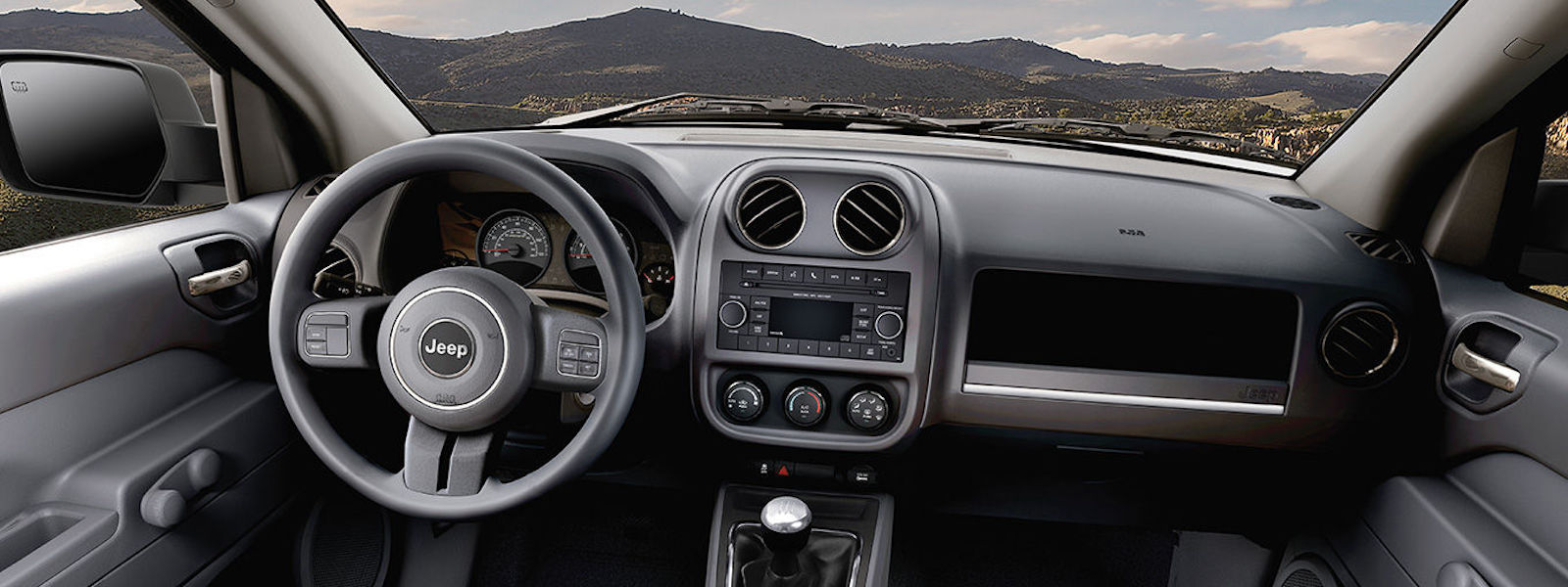 2016 Jeep Patriot Interior design with rolling mountain view