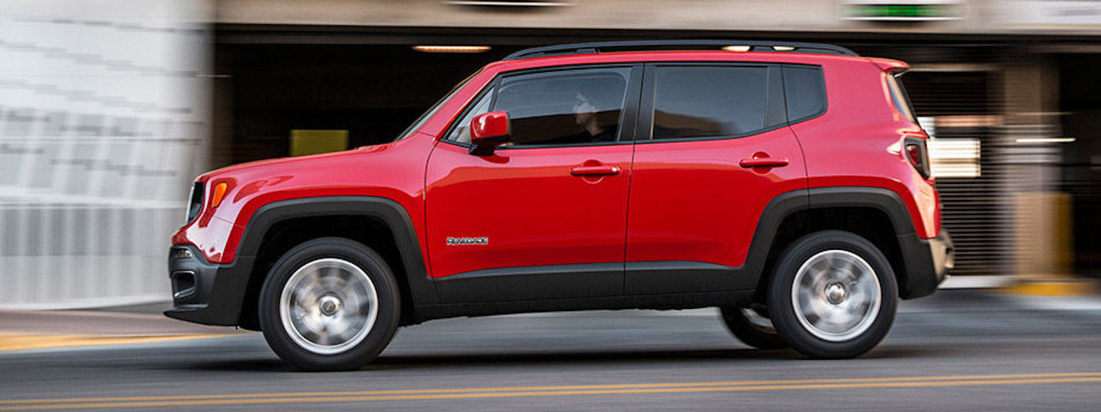 Red 2016 Jeep Renegade Driving down the street