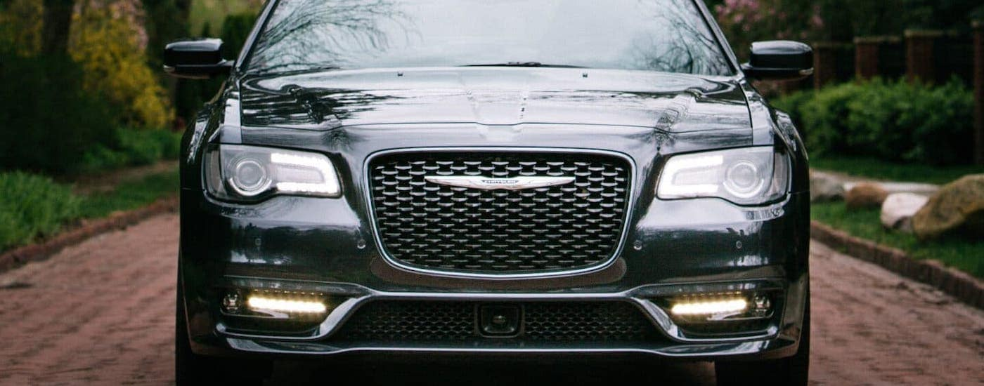 A black 2019 Chrysler 300 from a used car dealership in Colorado Springs is shown from the front.