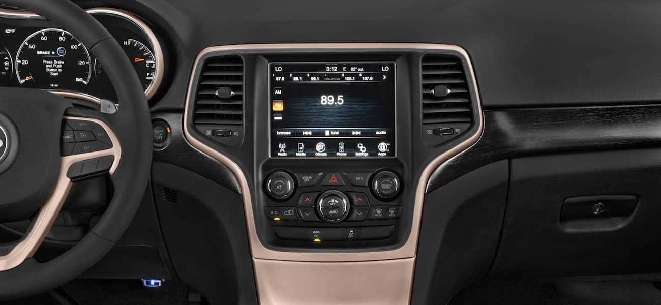 The dashboard and infotainment screen in a 2017 Jeep Grand Cherokee Laredo
