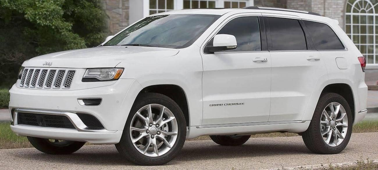A white 2017 Jeep Grand Cherokee Limited in a driveway