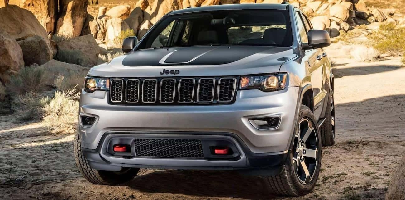 A silver 2017 Jeep Grand Cherokee Trailhawk on a rocky road