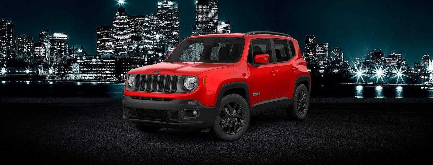Red 2017 Jeep Renegade in the city in Colorado Springs, CO.