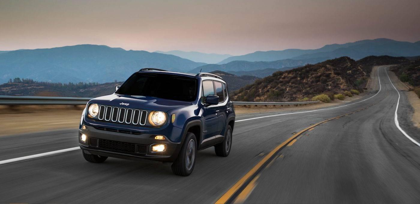 Blue 2017 Jeep Renegade Sport driving fast on a mountain highway in Colorado Springs, CO.