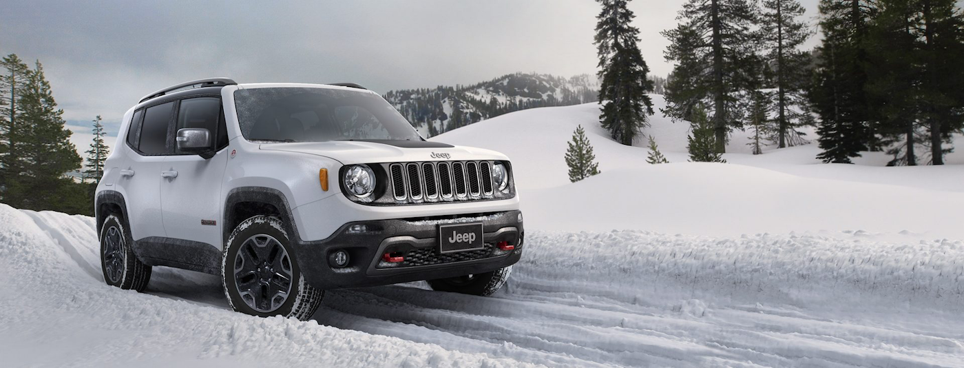 2017 Jeep Renegade Trailhawk driving in the snow with mountains in the background and there's a ghost in Colorado Springs, CO.