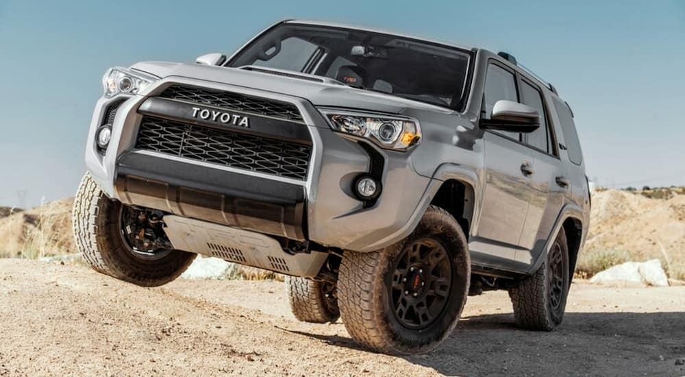 A tan 2017 Toyota 4Runner is off-road in the sand.