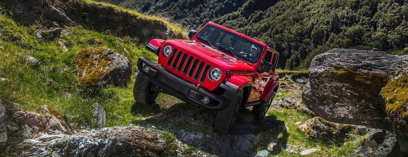 Red 2019 Jeep Wrangler JL climbing rocks near Colorado Springs