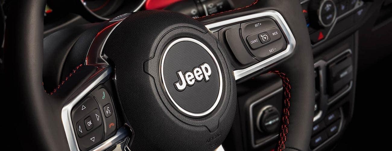 Closeup of black leather 2019 Jeep Wrangler Steering wheel taken near Colorado Springs