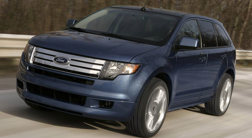 Blue 2009 Ford Edge driving on highway