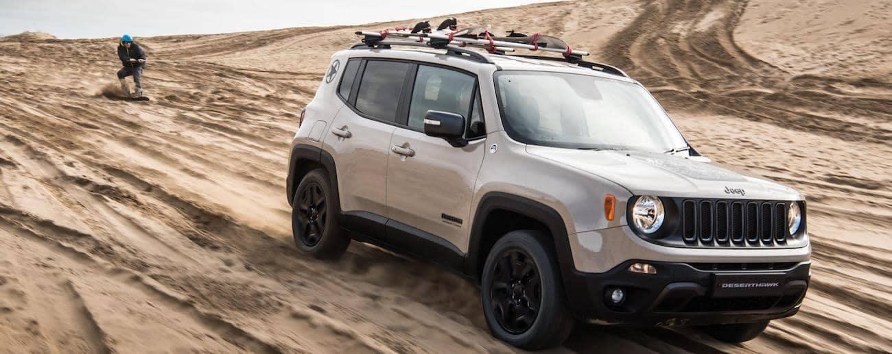 Colorado Springs - A tan 2019 Jeep Renegade blazes down a steep sandpit hill