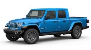 A Blue 2020 Jeep Gladiator is facing left with white background.